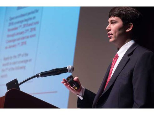 Brett Fowler of Turner, Wood & Smith Insurance tells audience members what they need to know about health care reform at the 2015 Greater Hall Chamber of Commerce Health Care Reform Seminar at the Brenau Downtown Center. - photo by Time file photo